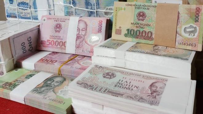 Đổi tiền lẻ, tiền mới lì xì trong dịp Tết nguyên đán phạt 30 triệu đồng