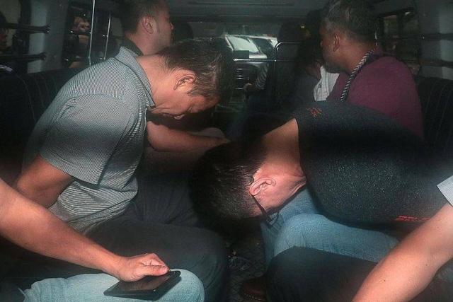 Các bị cáo trong đường dây trộm dầu của Singapore ra tòa hôm 13/1 (ảnh: Reuters)