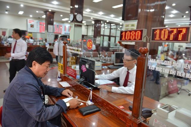 NHNN tăng tỉ lệ dự trữ bắt buộc tiền gửi VND ngắn hạn với Agribank - Ảnh 1.
