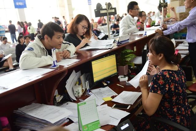 Cục Thuế TP.HCM ngừng bổ nhiệm quản lý cấp chi cục chờ sáp nhập - Ảnh 1.