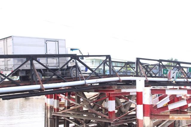 Hiểm nguy rình rập từ những cây cầu sắt xuống cấp ở Nhà Bè - Ảnh 7.