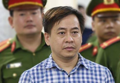 Bị cáo Phan Văn Anh Vũ trong phiên tòa sơ thẩm ngày 30/7. Ảnh: TTXVN.