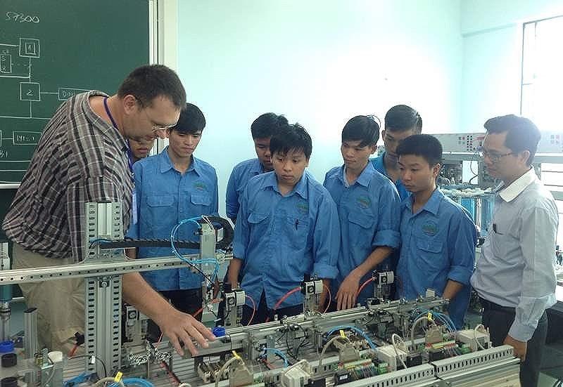 Lao động nước ngoài tại Việt Nam đủ 1 năm buộc phải đóng BHXH - ảnh 1