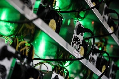 Đào NEM không cần máy tính cấu hình mạnh như Bitcoin. Ảnh: Bloomberg