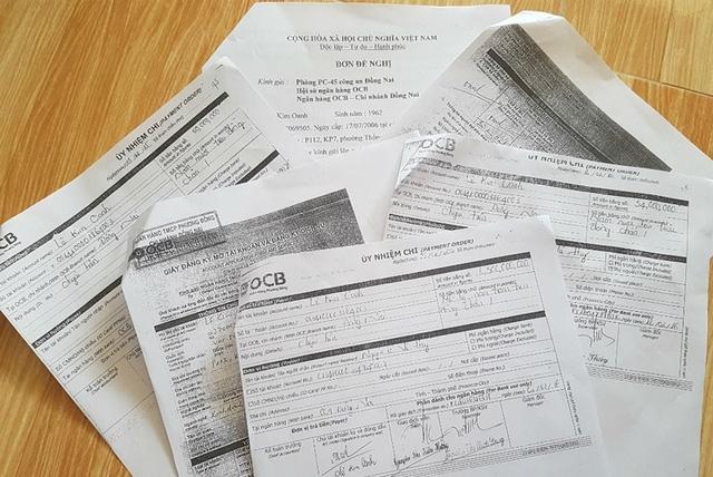 Các giấy ủy nhiệm chi tổng số tiền hơn 1,6 tỉ đồng, bà Oanh cho rằng mình không hề ký. Ảnh: VH