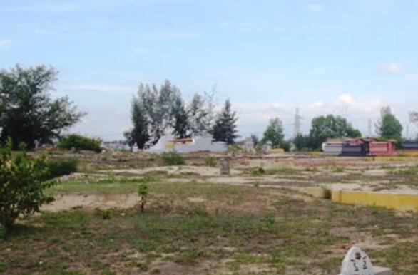 Khởi tố một loạt cán bộ phường bán cả đất nghĩa trang - Ảnh 1.