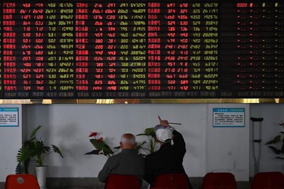 Chứng khoán châu Á tràn sắc đỏ khi căng thẳng thương mại Mỹ-Trung leo thang - Ảnh 2.