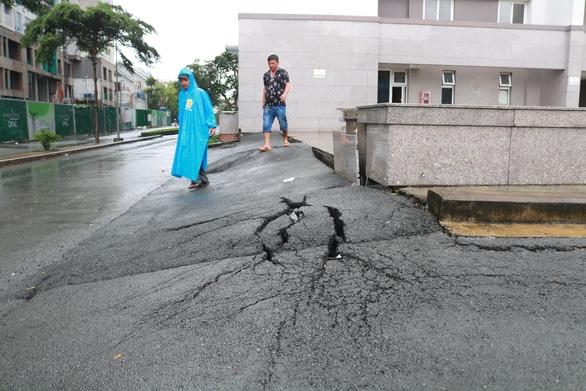 Bơm thêm gần 500 tỉ đồng sửa chữa đường Nguyễn Hữu Cảnh, liệu có hết ngập? - Ảnh 1.