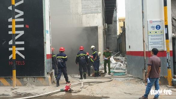 Cháy công trình khách sạn ở trung tâm quận 1, TP.HCM - Ảnh 3.