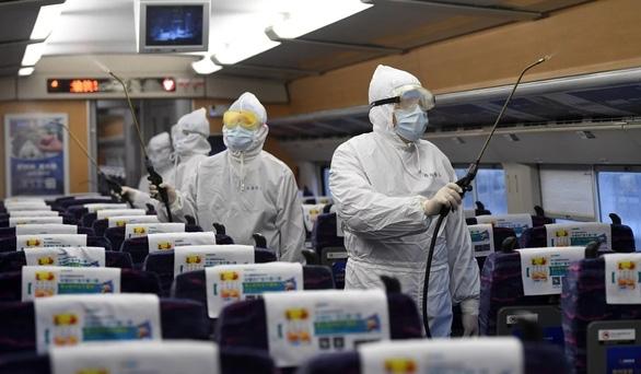 Dân Trung Quốc ngại quay lại làm việc dù thiếu hàng chống dịch virus corona - Ảnh 1.