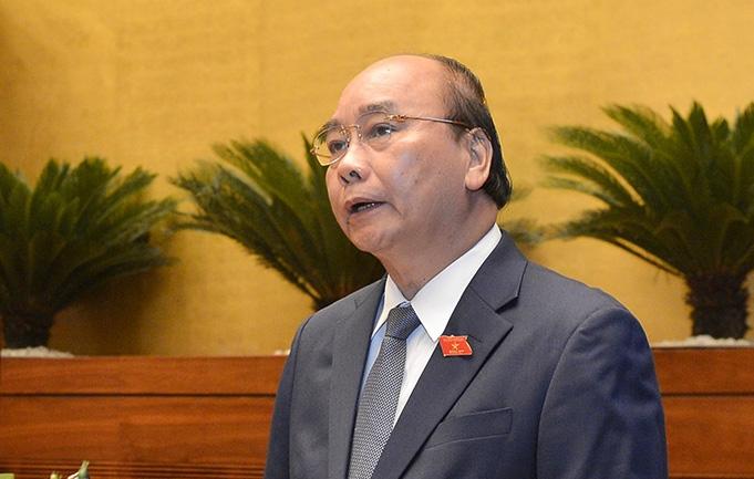 Thủ tướng Nguyễn Xuân Phúc trả lời chất vấn trước Quốc hội - Ảnh 1.