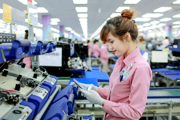 Từ 1-2-2021, lao động nữ đi làm ngày 'đèn đỏ' được nhận thêm lương - Ảnh 1.