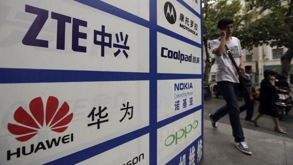 Mỹ công bố 5 siêu công ty của Trung Quốc vào nhóm đe dọa an ninh quốc gia - Ảnh 1.