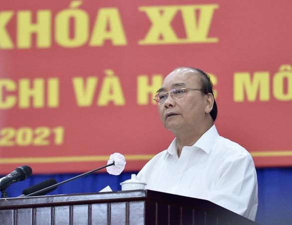 Chủ tịch nước Nguyễn Xuân Phúc: Ủng hộ đề xuất tăng tỉ lệ ngân sách để lại cho TP.HCM - Ảnh 1.