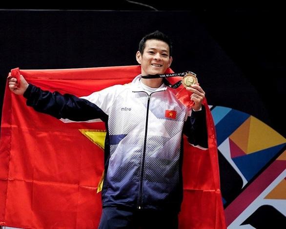 Cử tạ Việt Nam xuất sắc giành 3 vé đến Olympic Tokyo - Ảnh 1.