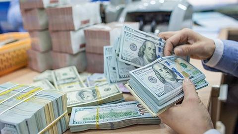 Lao động Việt Nam thu nhập bằng ngoại tệ có phải đổi ra tiền Việt mới đóng thuế?